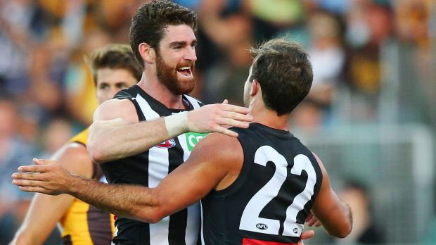 Tyson Goldsack (left) of the Magpies and Steele Sidebottom celebrate a goal.