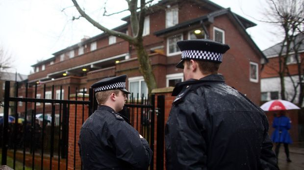 Police officers near the home of Islamic State militant Mohammed Emwazi, popularly known as Jihadi John.