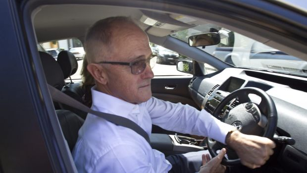 Communications Minister Malcolm Turnbull leaves his Sydney home on Friday.