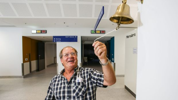 Survivor: Tommy Raudonikis rings the bell of the Nelune cancer centre at the Prince of Wales hospital.