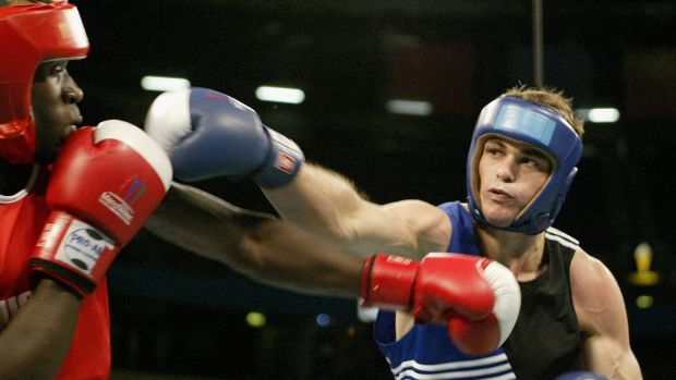 Ben McEachran in the ring with Joseph Lubega in 2002.