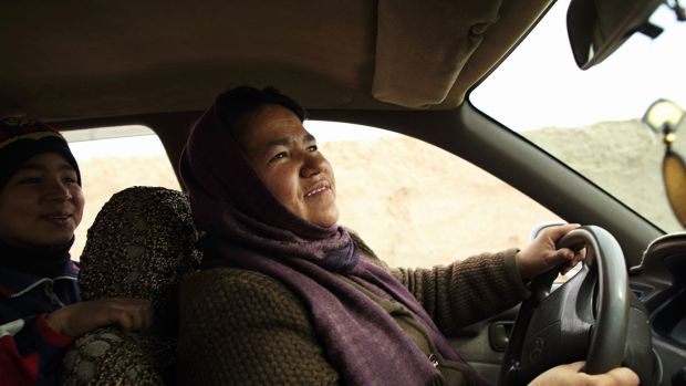 Sara Bahayi has had her taxi license for two years. The $10 to $20 she earns each day is enough to provide for her 15 ...