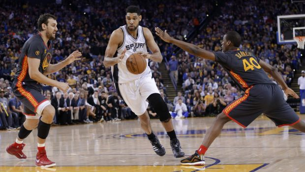 Ageless: San Antonio Spurs veteran Tim Duncan dribbles between Golden State Warriors duo Andrew Bogut and Harrison ...