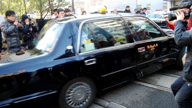 A vehicle, carrying a suspected teenager who killed a 13-year-old boy, enters a police station in Kawasaki, suburban ...