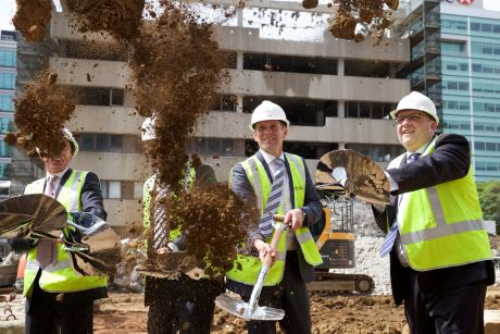 NSW Premier Mike Baird and Leighton Properties'  Andrew Borger turn the first sod to mark the official start of ...