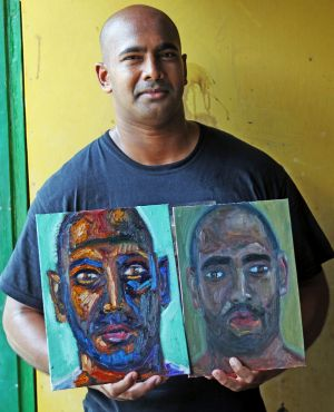 Myuran Sukumaran holding his self-portraits painted in the Kerobokan jail.
