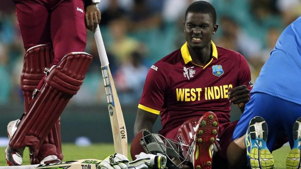 Jason Holder reacts after receiving treatment for cramps. The West Indian captain top scored with the bat and conceded ...