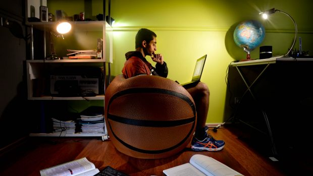 """Nossal High School student Abel Muller has embraced """"digital delivery days"""", studying at home as part of a virtual class."""