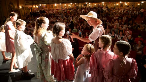 Moviegoers get dressed up and into the swing of things for the <i>Sound Of Music</i> singalong at the State Theatre.