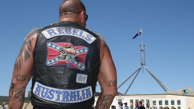 A patched Rebels member who was among riders protesting bikie laws at Parliament House in Canberra in December 2014.
