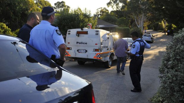 Police investigate the death of a woman at a Calwell home on Saturday.