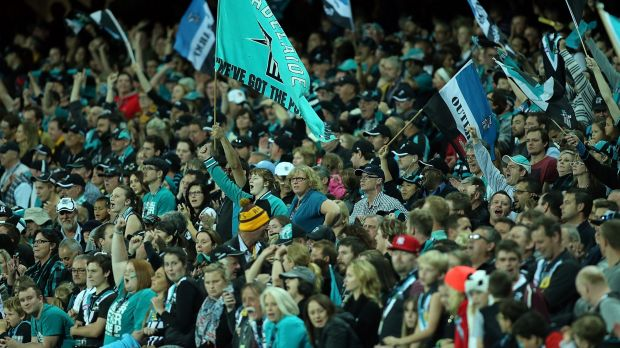 Fans enjoy the atmosphere during game between Port Adelaide and Hawthorn at Adelaide Oval last season.