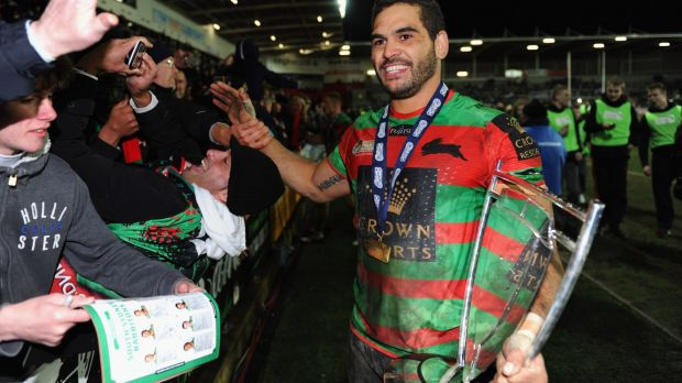 Champion again: Greg Inglis holds the World Club Challenge trophy in St Helens.