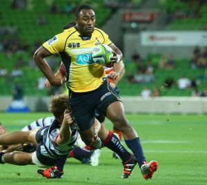 Tevita Kuridrani of the Brumbies breaks through a tackle to score a try.