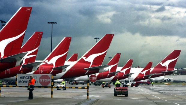 Qantas banned a passenger who asked to be removed from a flight because an asylum seeker was on board.
