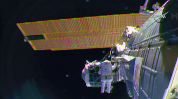 """A sense of urgency: Astronaut Barry """"Butch"""" Wilmore on a spacewalk outside the International Space Station in ..."""