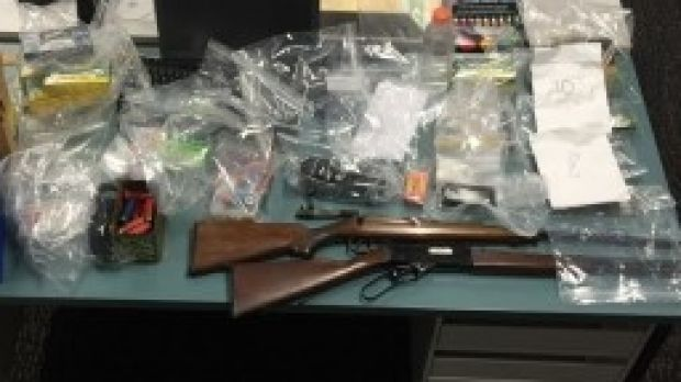 Guns were among items seized from an alleged Mongols associate.