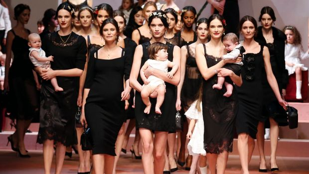 Dolce & Gabbana presented a baby-filled finale at their Milan fashion week show.