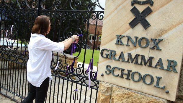Ribbons being tied to the gates at Knox Grammar School.