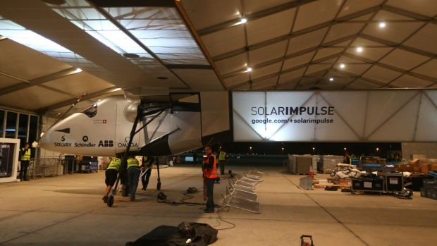 Members of the Solar Impluse 2 team prepare the solar-powered plane before a test flight at Abu Dhabi's small Al-Bateen ...