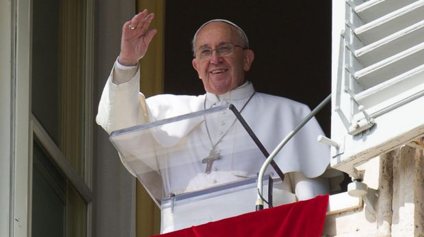 Outspoken opponent of Islamic State ... Pope Francis waves to the faithful from the window of his studio overlooking St ...