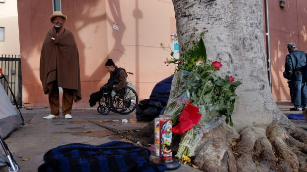 Ceola Waddell, 58, a homeless man who says he witnessed the police shooting on Sunday, stands by a memorial for the ...