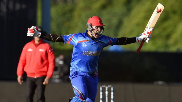 Big winner: Hamid Hassan celebrates as the winning runs were scored against Scotland.