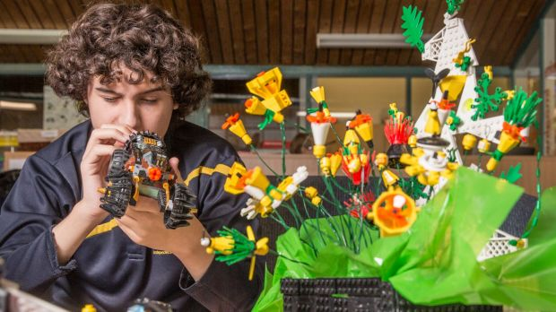 Year 10 Woden school student Jack Froggatt, 15, plays with some Lego in memory of student Mark Roberts who died last ...