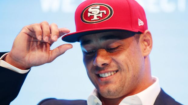 Hat's on: Jarryd Hayne at his press conference on Tuesday.