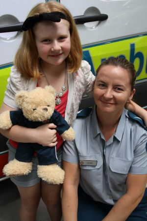 Mia Moyle, 8, and emergency medical dispatcher Rachel Colbourne who took her Triple 0 call.