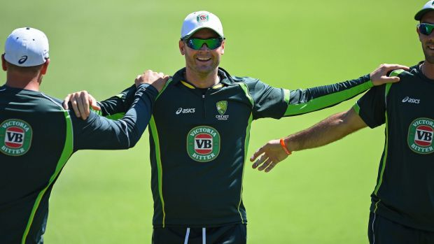 Australian captain Michael Clarke stretches with teammates during a training session in Perth on Tuesday.