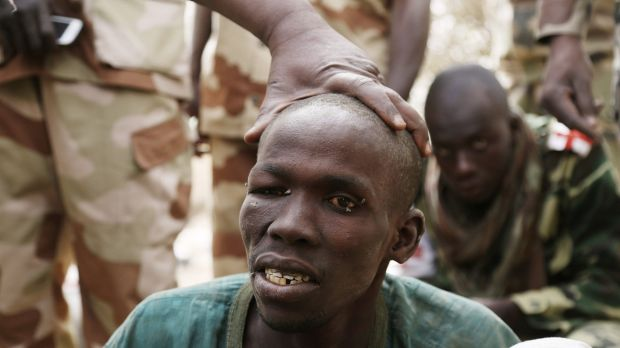 A man, whom the Chadian military say they have taken prisoner for belonging to Islamist group Boko Haram, is seen in ...