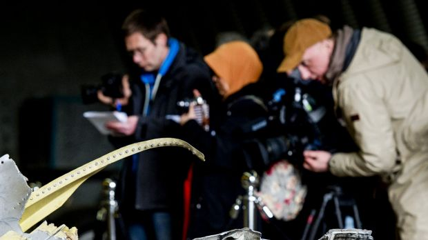 Members of the media view the wreckage of the Malaysia Airlines Flight MH17 in a hangar on  Gilze-Rijen airbase in the ...