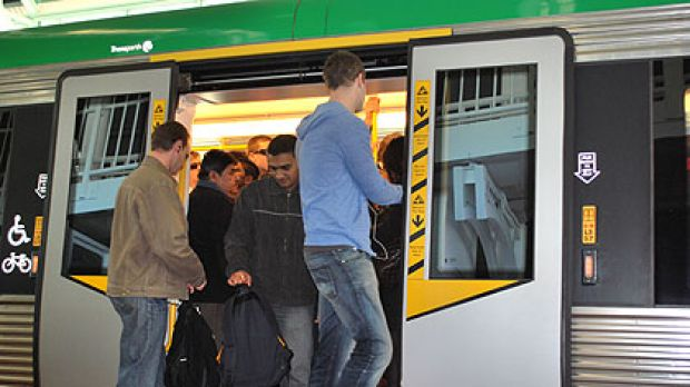 Commuters try to squeeze onto packed trains at Leederville station.