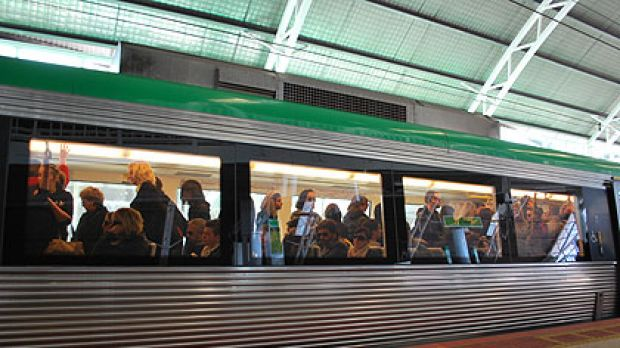 A packed train pulls into Leederville station.
