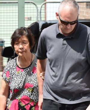 Helen Chan, the mother of  Andrew, leaves home enroute to Sydney Airport.