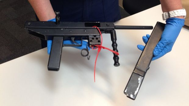 Police display an allegedly stolen weapon seized in Warnbro.