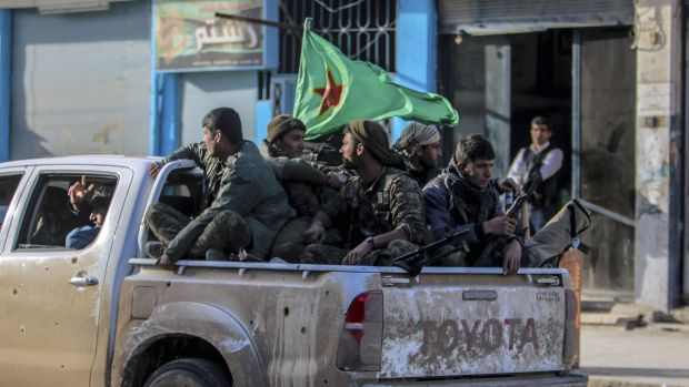 Fighters of the Kurdish People's Protection Units in the Syrian Kurdish city of Qamishli.