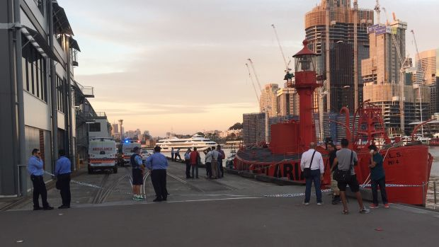 Police and ambulance workers at the scene in Pyrmont.