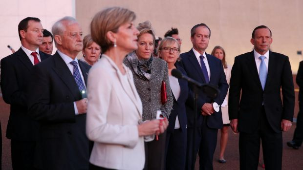 Foreign Minister Julie Bishop speaks during a candlelight vigil outside Parliament House.