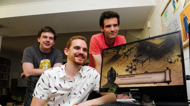 """Peter Castle, centre, with fellow creators from left, Peter Simpson and Tom Cox, have developed their game """"Tahira"""" ..."""