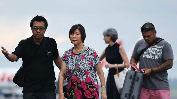 Australian Consulate staff assist Helen Chan, the mother of Bali Nine member Andrew Chan, followed by his brother ...