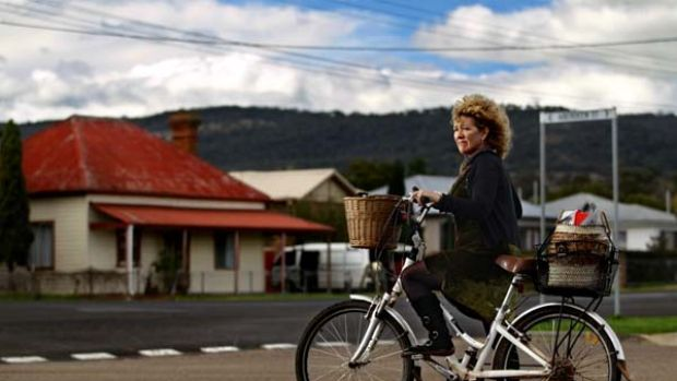 Scone unadorned ... Sue Abbott in the town where she was originally fined for riding her bicycle without a helmet. The ...