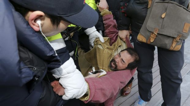 The alleged assailant identified as Kim Ki-Jong, 55, was immediately wrestled to the ground following the attack.