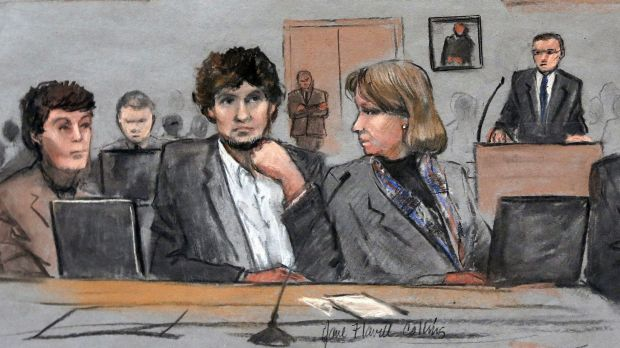In this courtroom sketch, Dzhokhar Tsarnaev  is depicted between his defence attorneys.