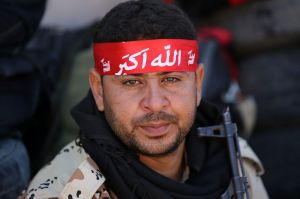 A volunteer Shiite fighter prepares to join the battle against IS for control of the Iraqi city of Tikrit.