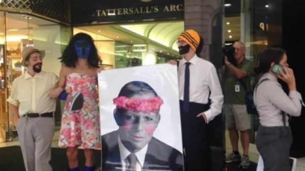 Female protesters dressed as men rally outside men-only club Tattersall's, where the LNP is holding its International ...