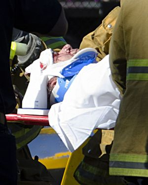 Paramedics attend to Harrison Ford, who was left with head injuries after the plane crash.