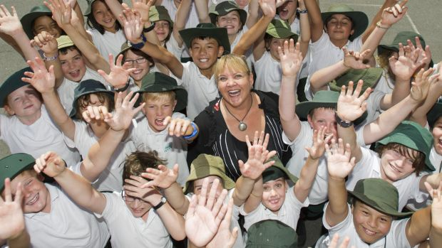 Acting Farrer primary principal Linda Heath with students celebrating the school's jump in the NAPLAN tables.