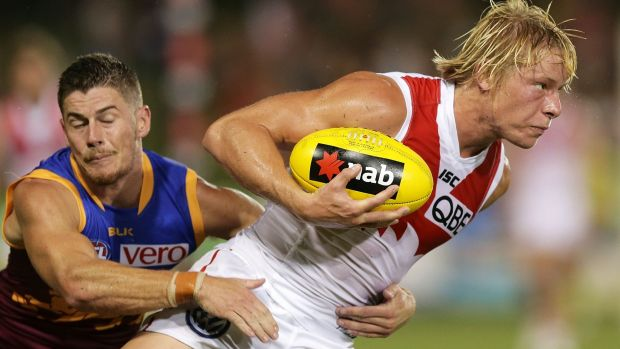 Caught: Swan Isaac Heeney is tackled during the clash with Brisbane.